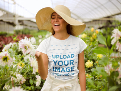Mockup of a Happy Girl Wearing a Tshirt and a Sun Hat in a Greenhouse 22500