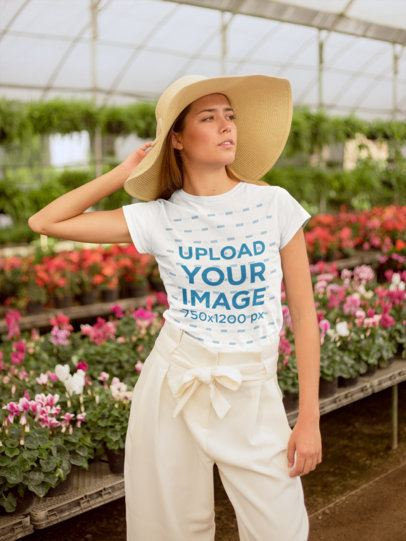 T-Shirt Mockup of a Woman with a Sun Hat in a Greenhouse 22503