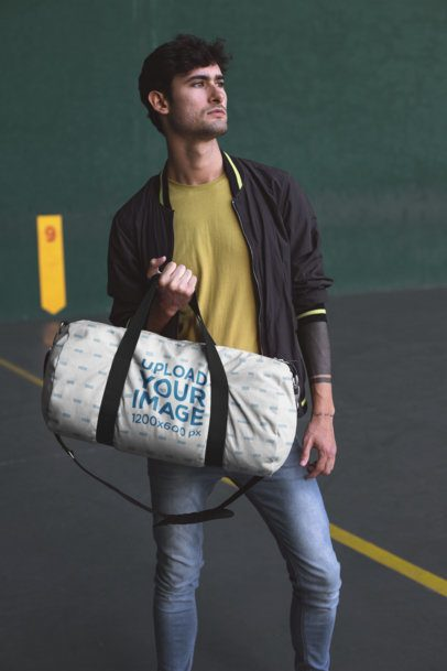 Mockup of a Gym Bag Held Casually by a Man 23229