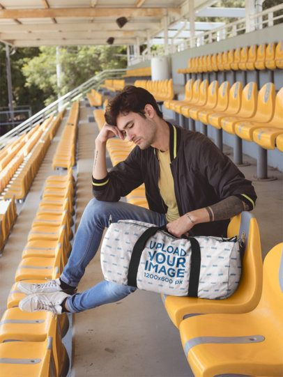 Mockup of a Thoughtful Man at a Stadium with a Duffel Bag 23247