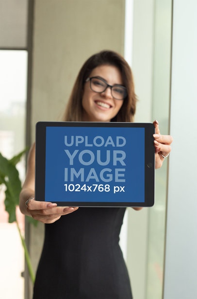 Mockup of a Happy Woman Showing an iPad in Landscape Position 22815