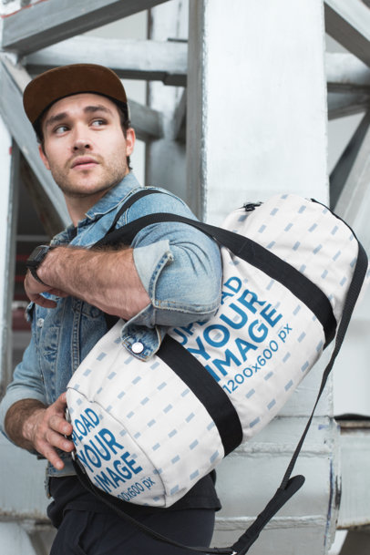 Mockup of a Young Man Carrying a Duffle Bag After the Gym 23056