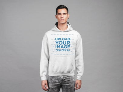 Mockup of a Man Wearing a Hoodie and a Pair of Distressed Jeans 21556