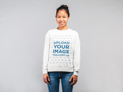 Mockup of a Happy Woman with a Messy Bun Wearing a Sweatshirt 21785