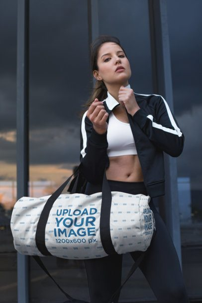 Mockup of a Gym Bag Held by an Athletic Woman 23046