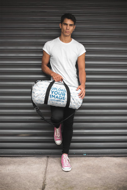 Gym Bag Mockup of a Man Leaning Against a Closed Store Curtain 23238