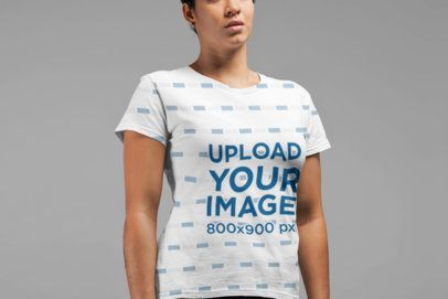 Mockup of an All Over T-Shirt Worn by a Muscular Woman in a Studio 21574