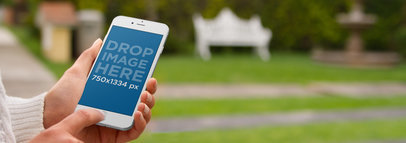 iPhone Mockup Featuring a Woman Using her iPhone 6 at the Park a4421