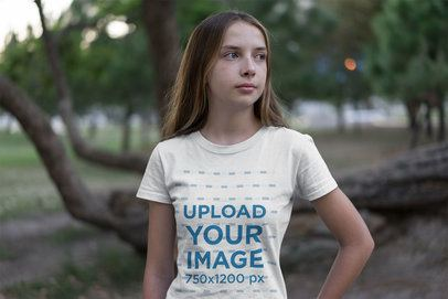 Mockup of a Serious Young Girl Wearing a Tee in a Park 20731
