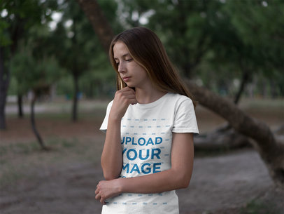 Mockup of a Young Woman Wearing a Tee in the Woods 20732