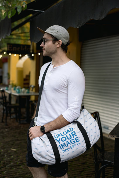 Duffle Bag Mockup of a Man Looking for a Restaurant 23065