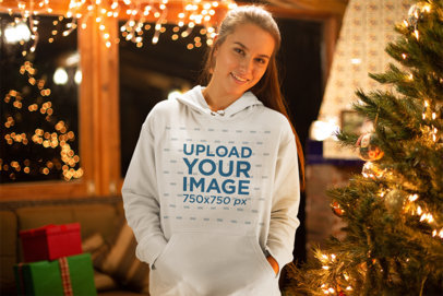 Pullover Hoodie Mockup of a Woman in Front of a Christmas Tree 23518