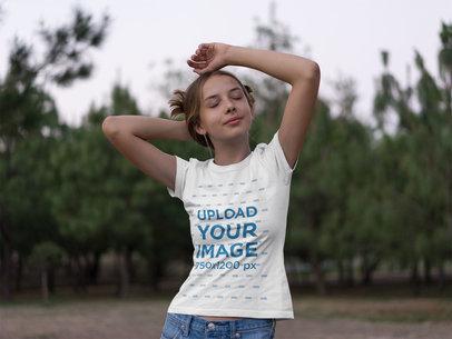 Tee Mockup Featuring a Teen Girl in a Field 20735