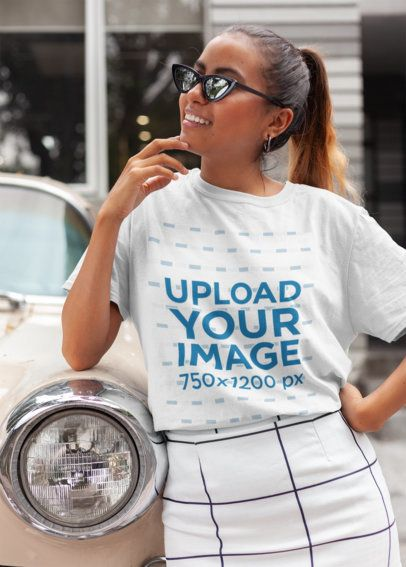 Unisex T-Shirt Mockup Featuring a Trendy Woman Leaning on a Classic Car 22793