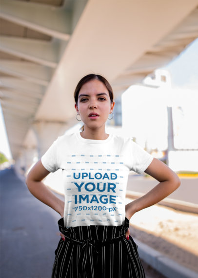 Mockup of a Woman Wearing a Tee and Posing Under a Bridge 20690