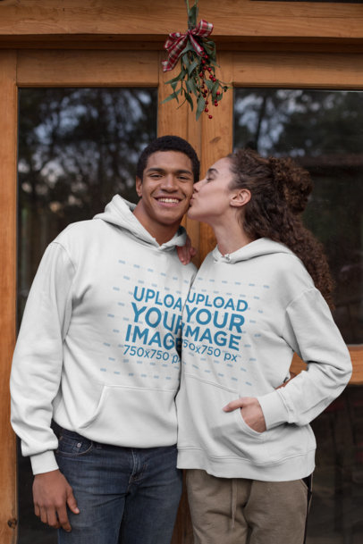 Hoodie Mockup Featuring a Couple Kissing Under Xmas Mistletoe 23508