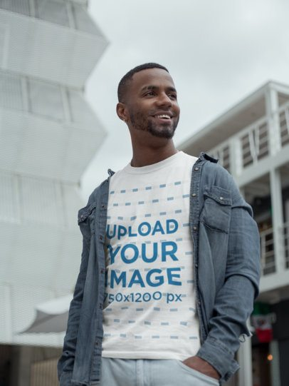 T-Shirt Mockup of a Smiling Man Walking in the City 22762