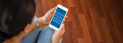 iPhone 6 Mockup Template of a Young Lady at Home a4508