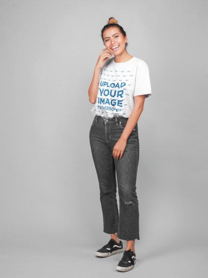 Unisex Tee Mockup of a Happy Woman Wearing Flared Jeans 22779