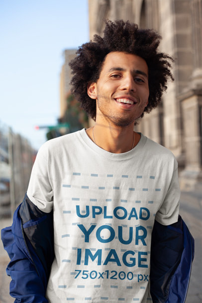 Tee Mockup of a Happy Man with an Afro Out on the Street 18071