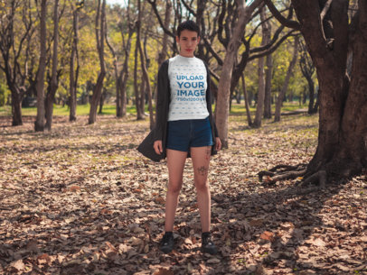 Tee Mockup of a Woman With a Pixie Cut Standing in the Middle of the Woods 20724