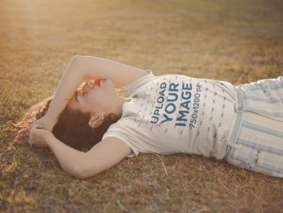 Mockup Featuring a Beautiful Woman Wearing a Tee Lying on Grass 19684