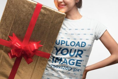 Christmas Tee Mockup Featuring a Woman Holding a Large Gift 23892