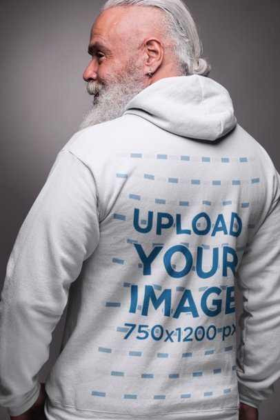 Back View Hoodie Mockup of a Trendy Older Man Posing in a Studio 23367