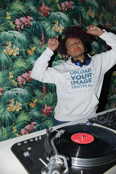 Hoodie Mockup of a Cool Female DJ with an Afro Mixing Some Tracks 23491