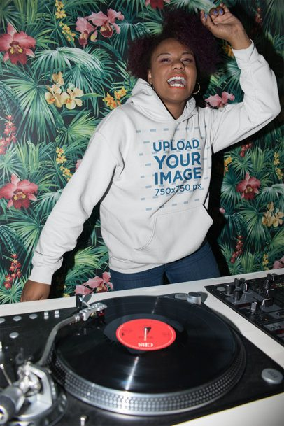 Pullover Hoodie Mockup Featuring a Playful Woman with Afro at the Dj Set 23490