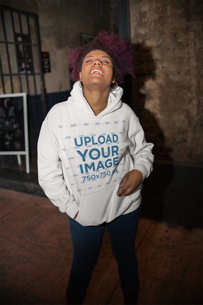 Pullover Hoodie Mockup of a Woman with Afro Hair Laughing 23494