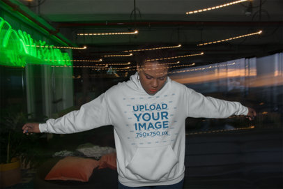 Hoodie Mockup of a Woman Surrounded by Distorted Lights 23485