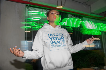 Pullover Hoodie Mockup of a Woman in Slow Shutter and Flash Photography 23483