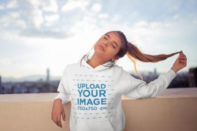 Hoodie Mockup Featuring a Pretty Girl Posing in the Sun 23288