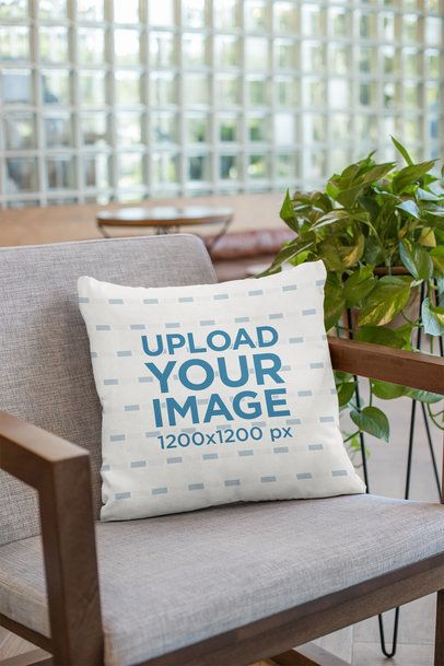 Mockup of a Pillow on an Armchair 23550