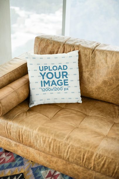 Mockup of a Square Pillow Sitting on a Leather Couch 23551