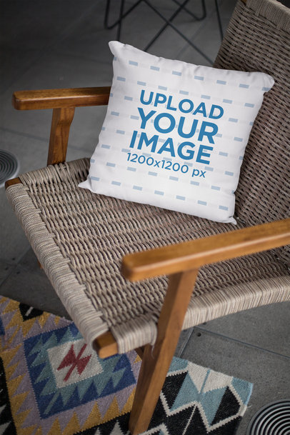 Mockup of a Square Pillow Placed on an Armchair in a Lounge 23552