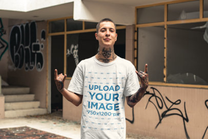 Tee Mockup of a Tattooed Punk Man in Front of an Abandoned Building 23458