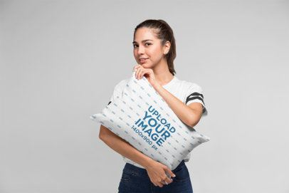 Pillow Mockup of a Beautiful Girl Hugging a Pillow in a Studio 23672