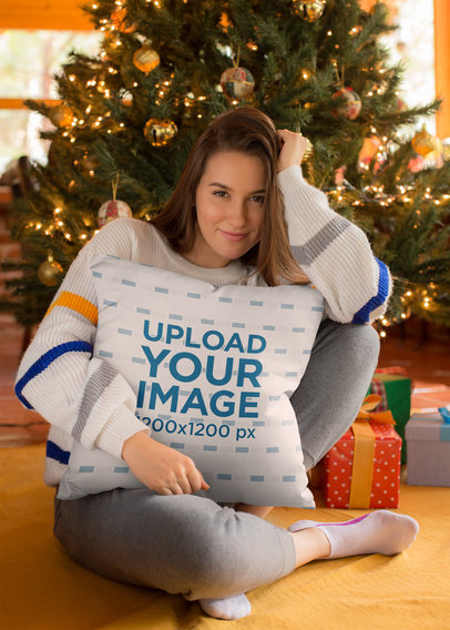 Square Pillow Mockup Featuring a Girl Under a Christmas Tree 23504