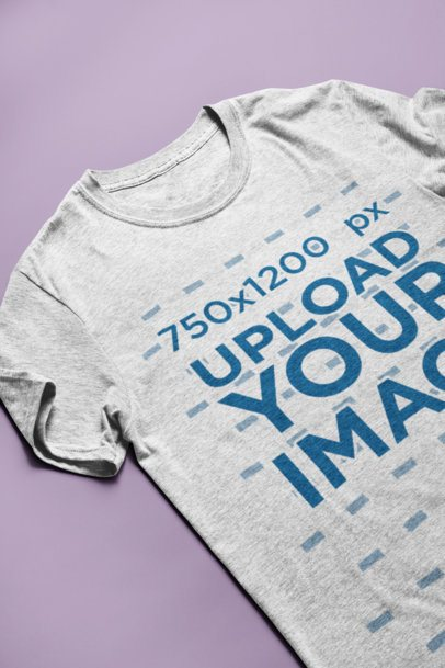 Mockup of a Heather T-Shirt Lying on a Solid Surface 24207