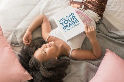 Book Mockup of a Cute Little Girl Lying on Her Bed Dreamily 23701