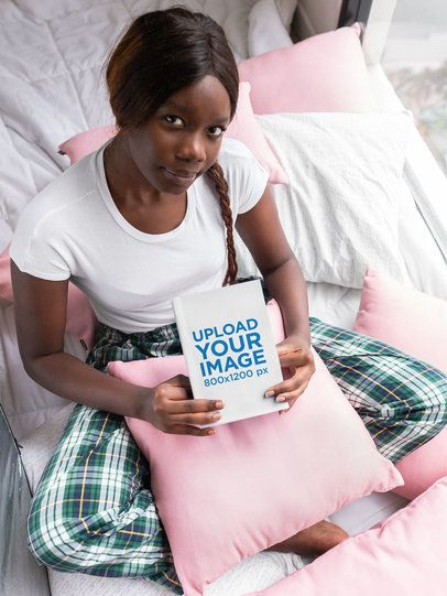 Book Mockup of a Girl with a Braid Sitting on Her Bed 23707