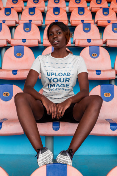 Sports Jersey Mockup of a Girl Sitting on a Stadium 23646