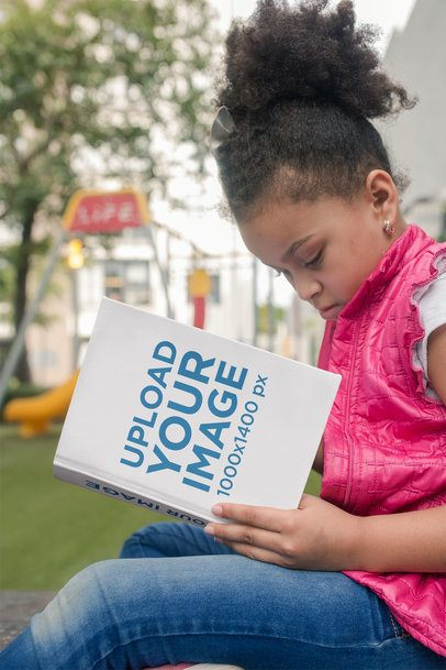 Book Mockup of a Little Girl Reading near the Playground 23716