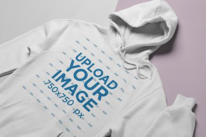 Mockup of a Hoodie Lying Over a Surface with Two Colors 24257
