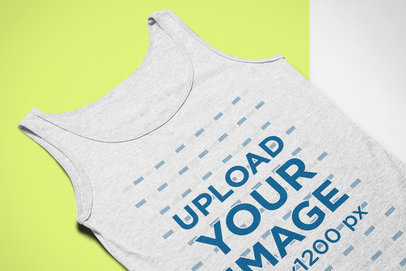 Mockup of a Heather Tank Top Lying on a Flat Bicolor Surface 24249