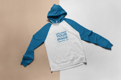 Mockup of a Raglan Hoodie Over a Duo-Colored Surface 24233
