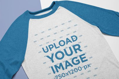 Mockup of a Crew Neck Raglan T-Shirt Lying on a Flat Surface 24262