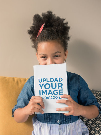 Book Mockup of a Child on a Sofa 23723